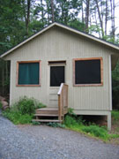 image of a Singing Pines shelter, including steps up to door