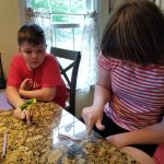 campers make paper frogs