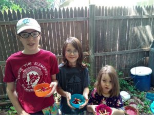 "three campers hold bowls of ""edible fire"""